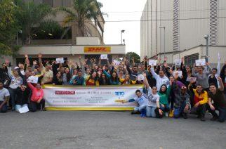 Colaboradores da DHL participam de ação voluntária da ONG TETO Brasil